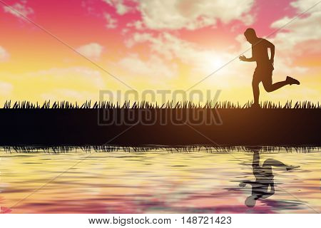 silhouette of jogger in sunset and reflection