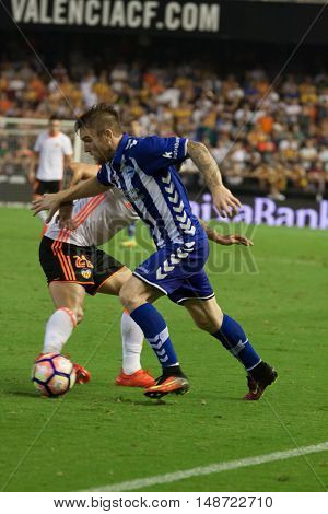 VALENCIA, SPAIN - SEPTEMBER 22nd: Katai (R) with ball during Spanish soccer league match between Valencia CF and Deportivo Alaves at Mestalla Stadium on September 22, 2016 in Valencia, Spain