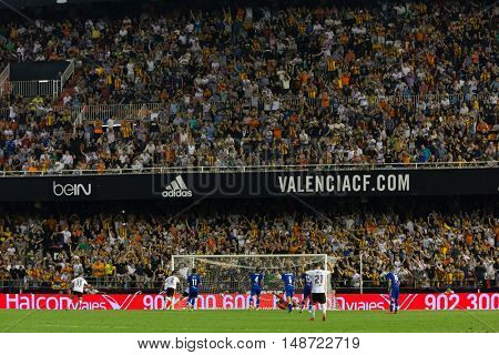 VALENCIA, SPAIN - SEPTEMBER 22nd: Supporters celebrating a goal during Spanish soccer league match between Valencia CF and Deportivo Alaves at Mestalla Stadium on September 22, 2016 in Valencia, Spain