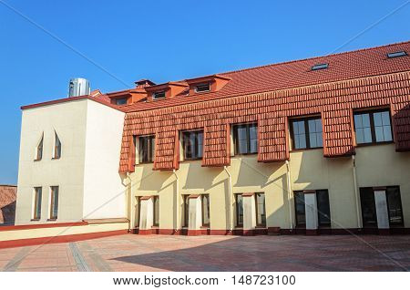 New building with red tiled roof in Trinity Suburb Minsk Belarus