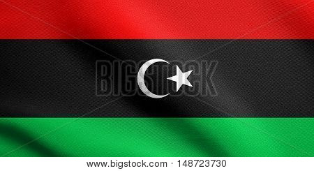 Libyan national official flag. African patriotic symbol banner element background. Flag of Libya waving in the wind with detailed fabric texture, illustration