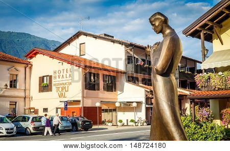 Kobarid Slovenia September 7 2014 View of Trg Svoboda and statue of Simon Ggregorcic in foregorund.