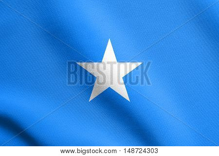 Somali national official flag. African patriotic symbol banner element background. Flag of Somalia waving in the wind with detailed fabric texture, illustration