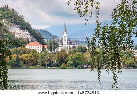 View of St. Martin church across Lake Bled Slovenia