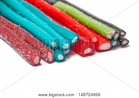 Sweet jelly licorice candy sticks with different flavor, isolated on white background