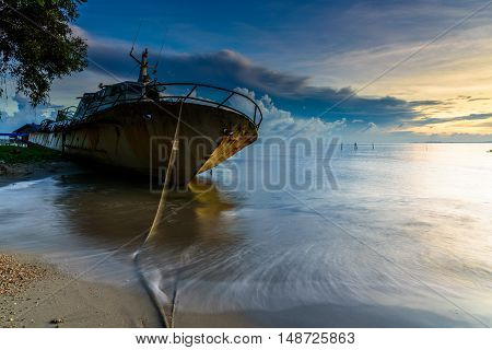 Abandoned broken ferry ship wreck known as Duta Muhibbah Dua beached on sea shore.