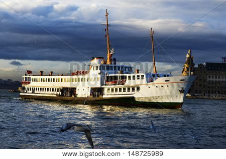 Istanbul Turkey - January 19 2013: Istanbul throat historic Haydarpasa train station and the ferry. Ferries in Istanbul commuter ferries have been operating on the Bosphorus since 1851. Boats have traversed the waters of the Bosphorus for millennia and un