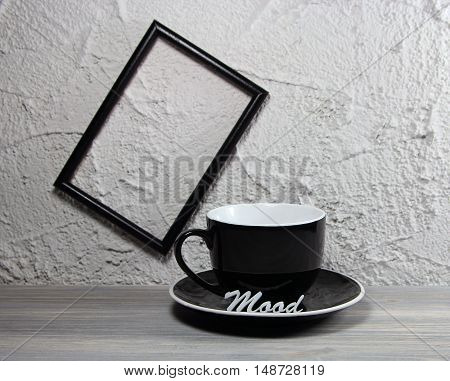 cup black empty with an inscription mood and an empty frame for the photo