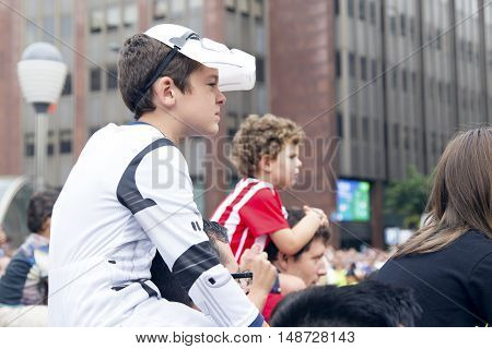 Boy Dressed Like A Stormtrooper Looking At A Parade.