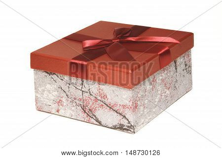 An isolated shot of a red gift box with the lid on tight.