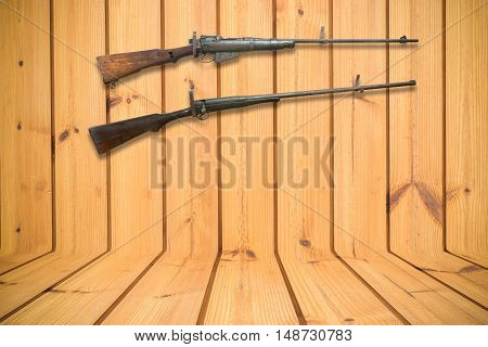 old gun and wooden background - square format
