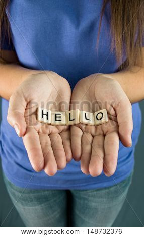 Hello Spelled in Tiles in a young girls hands