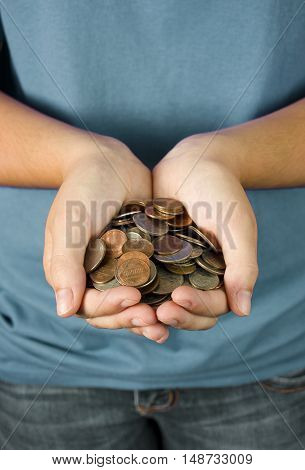 A Teenager Holding a Handful of Coins