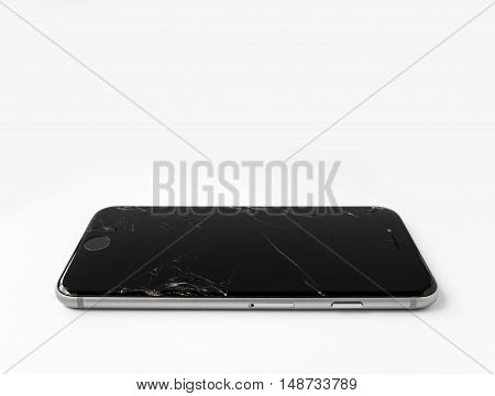 CHIANGRAI THAILAND -SEPTEMBER 18 2016: Close up image of broken Apple iPhone 6 with cracked screen isolate on white with copy space.
