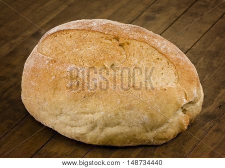 Loaf of Sourdough Bread on a wooden table