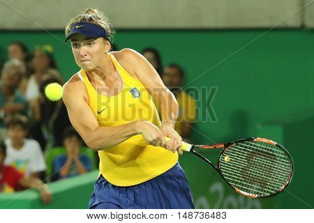 RIO DE JANEIRO, BRAZIL - AUGUST 9, 2016: Professional tennis player Elina Svitolina of Ukraine in action during singles round three match of the Rio 2016 Olympic Games against Serena Williams of USA