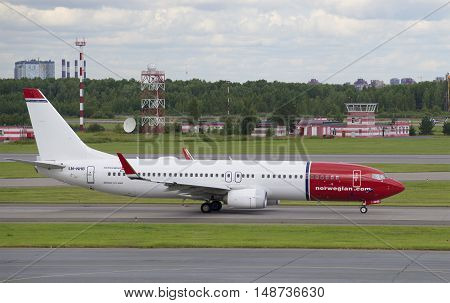 SAINT PETERSBURG, RUSSIA - JULY 27, 2015: The Boeing 737-800 (LN-NHB) Norwegian Air Shuttle on the runway of the Pulkovo airport