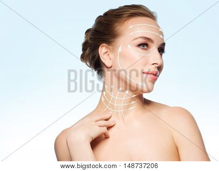 beauty, people, plastic surgery, anti-age and health concept - beautiful young woman touching her neck over blue background