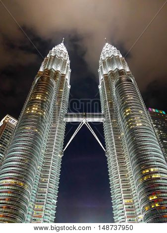 KUALA LUMPUR MALAYSIA - FEBRUARY 29: Petronas twin towers in night scene on February 29 2016 in Kuala Lumpur Malaysia. Night time of twin towers.