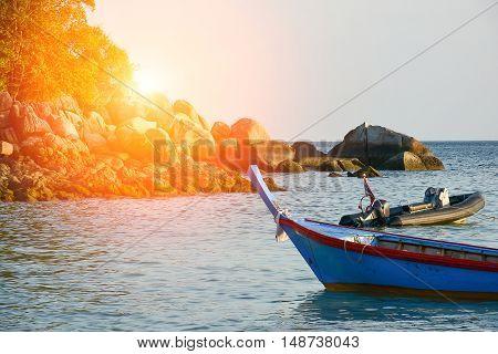 Fishing Boats And Sunrise Flare