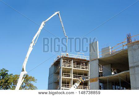 Concrete Highrise Construction site, Concrete Pumper with raised boom