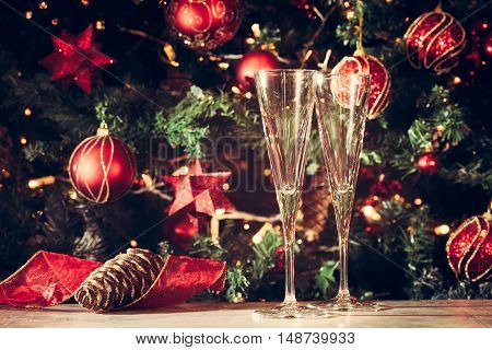 Getting Ready! Two Empty Glasses With Christmas Tree Background. Holiday Season Background. Traditio