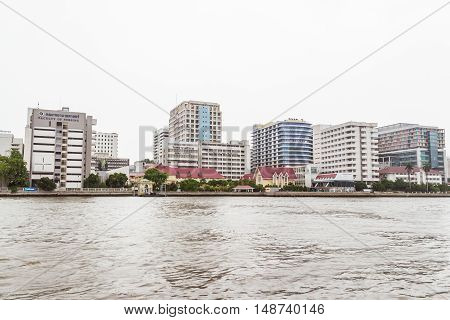 Bangkok Thailand - June 5 2016: Siriraj Hospital view from the other side of Chao Phraya River on cloudy day. It is the oldest and the most famous hospital in Thailand and part of Mahidol university
