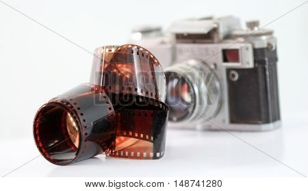 picture of a vintage camera film rolls on white background
