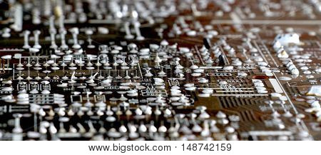 Part of old vintage printed circuit board with electronic components.