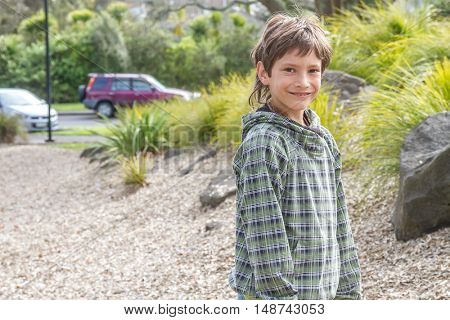 outdoor portrait of young happy boy at playground