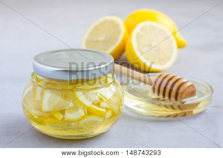 Lemon and honey mix for citrus tea in glass jar ingredients on background horizontal copy space