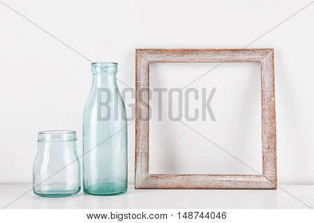 Photo frame with bottles on table