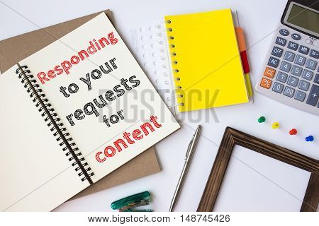 Text Responding to your requests for content on white paper book on table / business concept