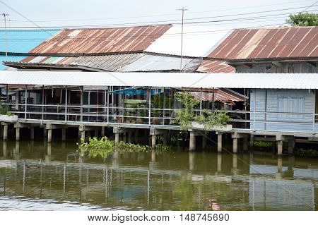 close up waterfront old home in country thailand