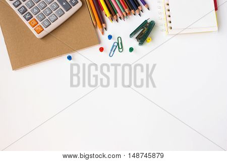 Office desk table with supplies, paper, pencil, notebook / Top view with copy space