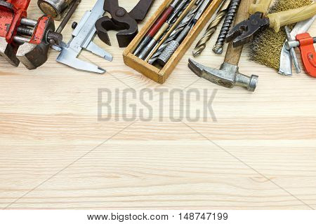 Old Tool Set Of Various Instruments For House Repair And Construction On Wooden Background