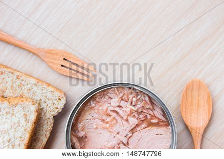 bread and tuna on wood table background / copy space / top view