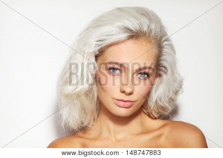 Portrait of young beautiful platinum blond woman with clean natural make-up