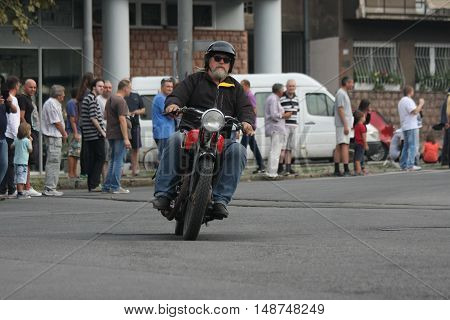 BELGRADE,SERBIA - SEPTEMBER 10 ,2016: Oldtimer motorcycle at the commercial race of old cars in memory of formula 1 race held on the same place in 1939 two days after the beginning of Second World War when the famous Italian driver Tazio Nuvolari won