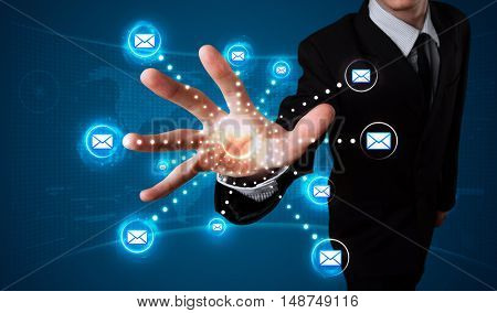 Young businessman pressing virtual messaging type of icons