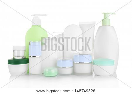 Different cosmetic bottles isolated on white