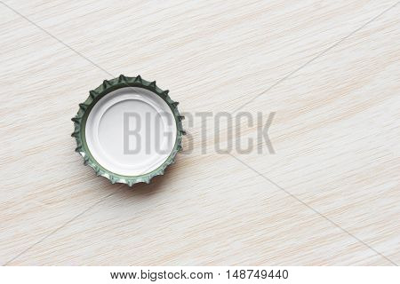 bottle caps on wood texture / bottle caps