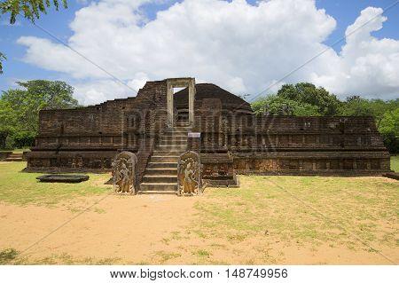 On the ruins of an ancient temple Manik Vehera. Polonnaruwa, Sri Lanka