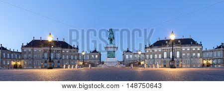 Copenhagen, Denmark - June 05, 2016: Panoramic Evening photography of Amalienborg Palace and the statue of Frederik V