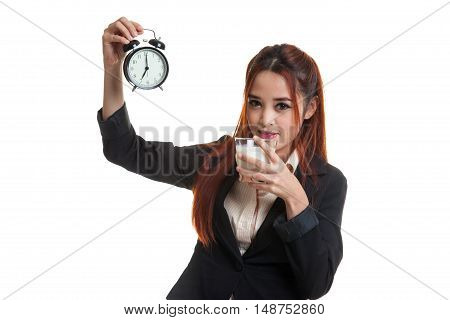 Healthy Asian Woman Drinking  Glass Of Milk Hold Clock.