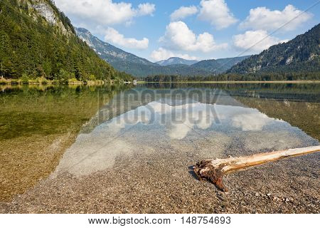 Wooden Trunk In Front Of Lake Offensee