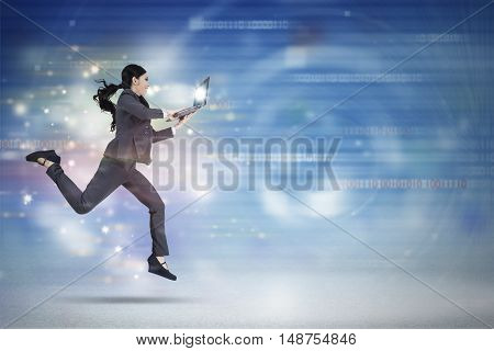 Concept of fast internet connection with female entrepreneur working with laptop while running in virtual world