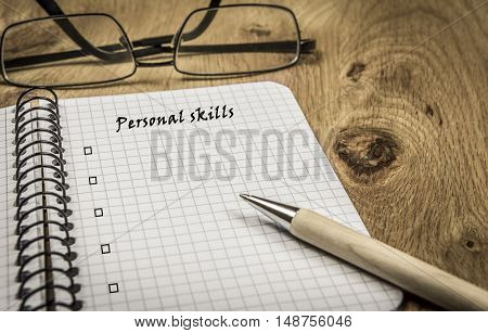Personal skills list - Spiral maths notebook with copy space for personal skills list on a retro wooden desk
