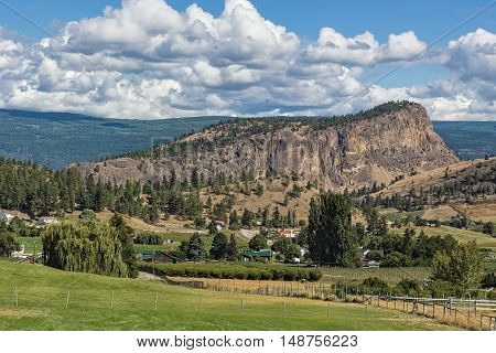 Giants Head Mountain near Summerland British Columbia Canada with farmland in the foreground