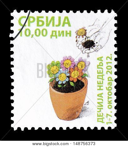 SERBIA - CIRCA 2012 : Cancelled postage stamp printed by Serbia, that shows Flowers and hands.